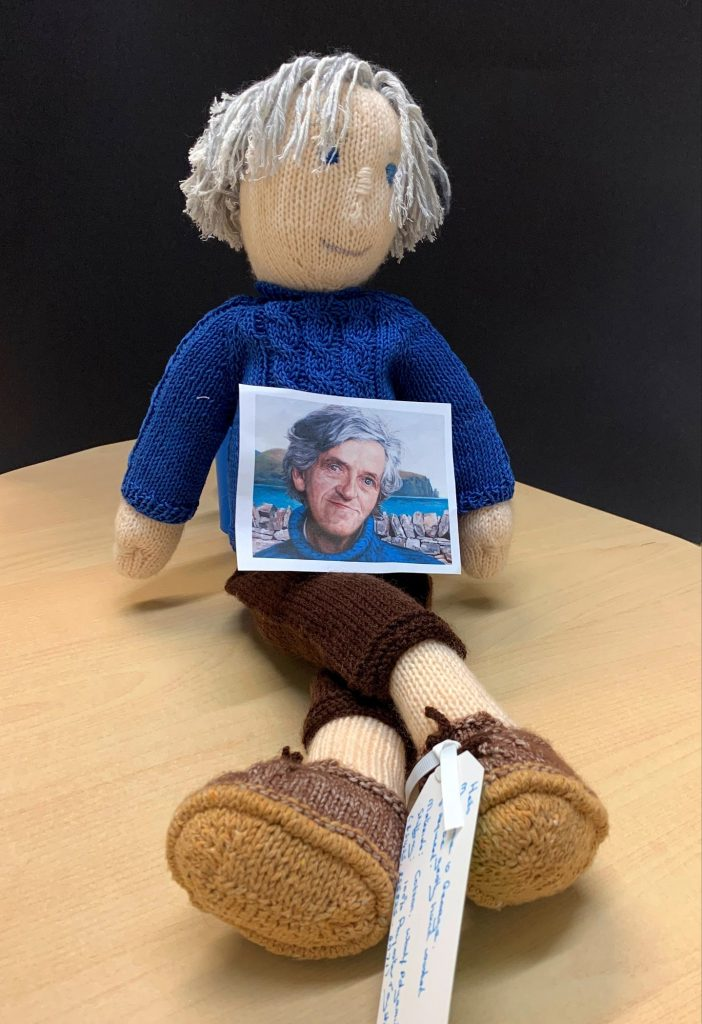 A knitted George Mackay Brown doll